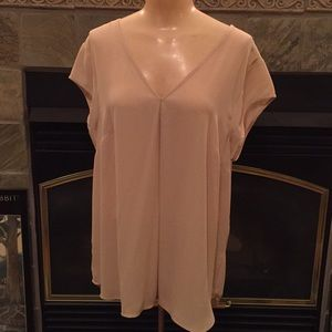 Silky tan top with deep V back and anchoring strap
